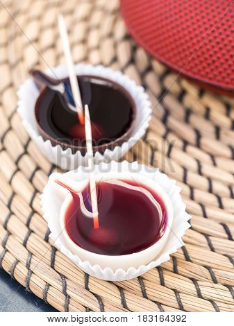 Ginja de Obidos traditional sour cherry liquor served in small cups made of chocolate.