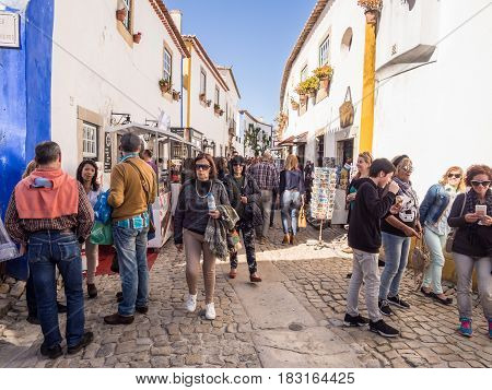 OBIDOS PORTUGAL - APRIL 02 2017: Crowd on the main street of Obidos during the chocolate festival 2017.