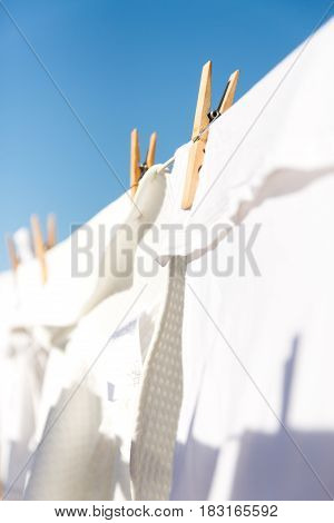 White Clothes Hung Out To Dry In The Bright Warm Sun