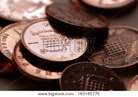 The pence on a background of coins
