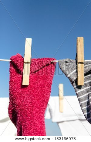 Colorful Clothes / Socks Hung Out To Dry In The Bright Warm Sun