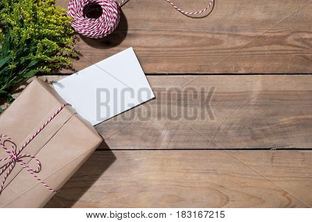 Present Box On Wooden Table. Flat Lay With Copy Space. Celebration, Holiday Season And Winter Concep