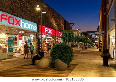ASHDOD, ISRAEL - JULY 03, 2016: Shops and boutiques in open air mall at evening - owned by BIG Shopping Centers Ltd., founded in 1994 and operates in four countries.