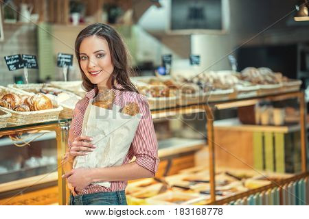 Attractive woman in bakery
