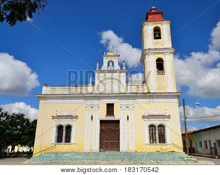 Facade of the colonial church by the Maceo square in the Sancti Spiritus town on Cuba