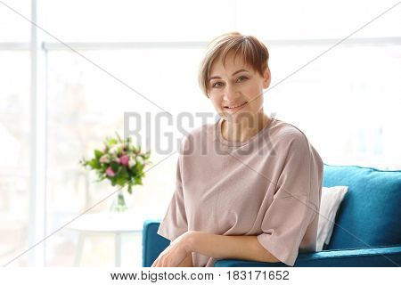 Beautiful mature woman resting at home