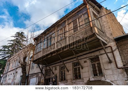 TBILISI, GEORGIA - APRIL 04, 2017: Street of old city, Tbilisi at the spring. Historically Tbilisi has been home to people of multiple cultural, ethnic, and religious backgrounds.