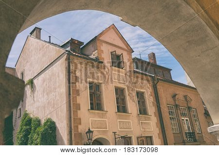 Old house with open Windows in the sky in the arch in the Latvian capital Riga