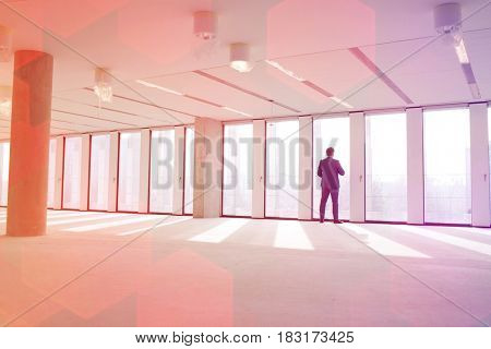 Rear view of mature businessman visiting empty office space