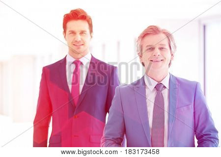 Portrait of smiling mature businessman and male colleague in office