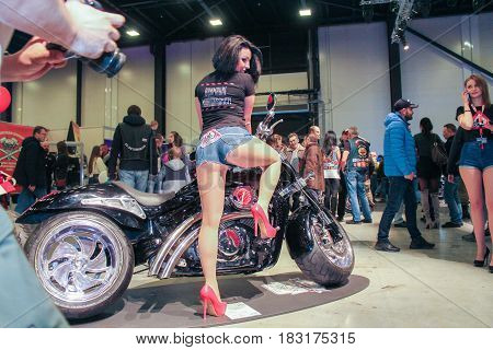 St. Petersburg Russia - 15 April, The model is posing for a motorcycle,15 April, 2017. International Motor Show IMIS-2017 in Expoforurum. Models on motorcycles presented at the motor show.