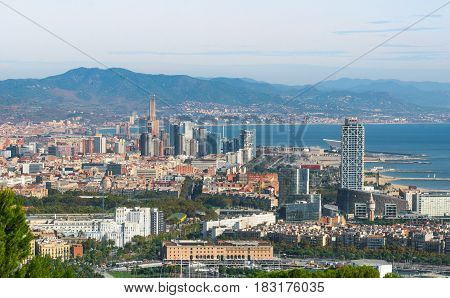 Beautiful Blue commerce in the ports of Spain in Barcelona.  Balearic sea & coastline of modern cosmopolitan city seen from high, cable car over the city.