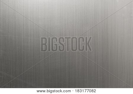 Stainless steel background texture with scratches and abrasion marks