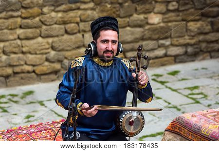 Azerbaijan, Baku, March 15, 2017. Musician is playing. Traditional oriental musical instrument