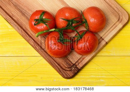 Tomatoes, Cherry On Vine On Cutting Board, Yellow Vintage Background