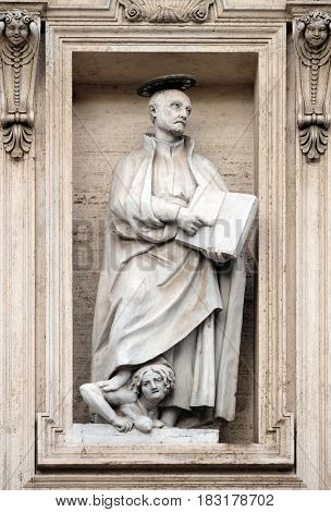 ROME, ITALY - SEPTEMBER 01: Saint Ignatius of Loyola on the facade of the Church of the Gesu, mother church of the Society of Jesus, Rome, Italy on September 01, 2016.
