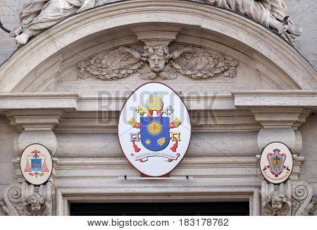 ROME, ITALY - SEPTEMBER 01: Coat of arms of Pope Francis on the portal of Sant Andrea della Valle Church in Rome, Italy on September 01, 2016.
