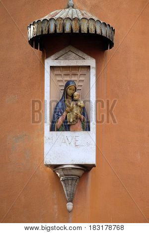 ROME, ITALY - SEPTEMBER 01: Ave Maria Image of Virgin Mary with baby Jesus on the facade of a palace in Rome, Italy on September 01, 2016.