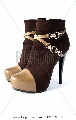 Pair of fasionable brown susede women boots with high heels isolated on white background