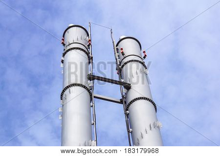 industrial boiler flues, against the cloud and blue sky .