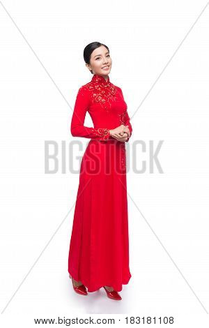 Full Body Of Charming Vietnamese Woman In Ao Dai Traditional Dress Isolated On White.
