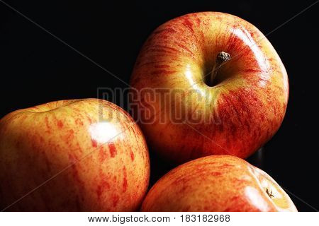 Juicy and ripe red apples isolated on a black background