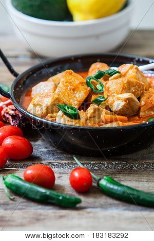 Thai red curry fish with green pepper on pot