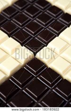 Dark and white chocolate bars combined together