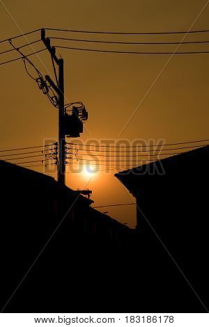 Silhouette of electric transformer in the eveving before the sunset.