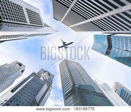 Business downtown skyscrapers and airplane in skies.