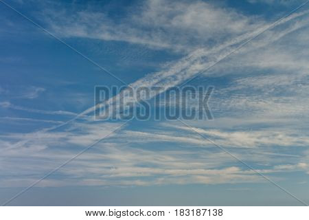 Blue sky with clouds and airplane trails. Beautiful background abstract Nature composition.
