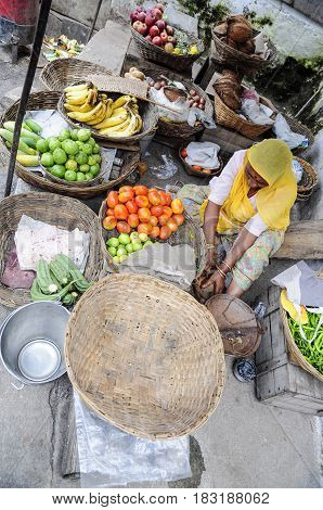 Udaipur, India, september 14, 2010: Old women selling vegetables and fruits on a local street market in Udaipur.
