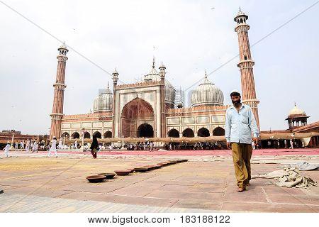 Delhi India september 3 2010: Muslim men walking on in front of mosque Masjid in Delhi India.