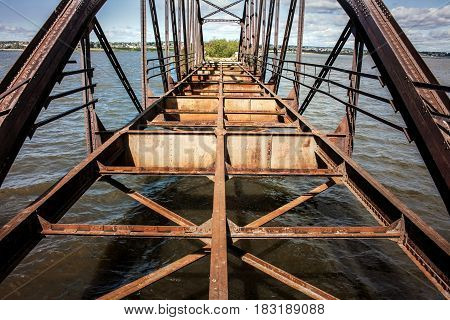 The old rusty bridge with rivets constructed in the 18th century