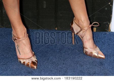 LOS ANGELES - APR 22:  Laura Vandervoort (shoe detail) at the 2017 The Humane Society Gala at Parmount Studios on April 22, 2017 in Los Angeles, CA