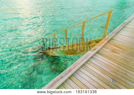 Wood stair into the sea of tropical Maldives island