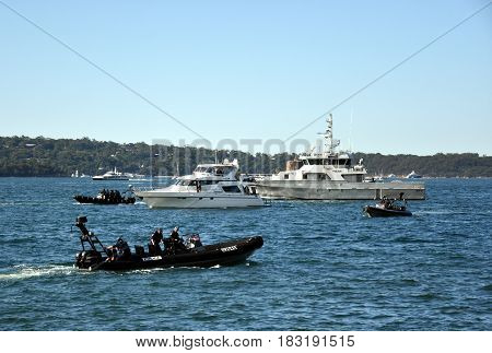Sydney Australia - Apr 23 2017. Policemen invigilate at Opera House on boats before arriving Mike Pence the vice president of the United States.