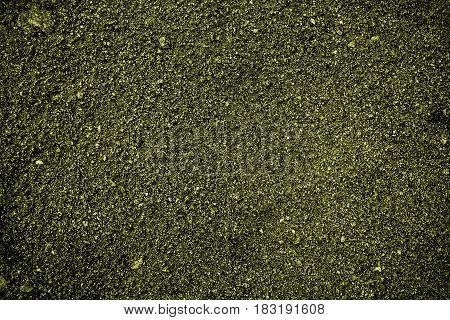 Soil, green soil background, soil texture, green soil. Earth, green earth background, ground texture.
