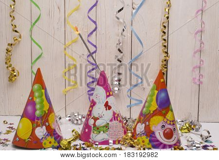 Greeting card for carnival party. Party hat and candles on white background. Toning instagram filter.