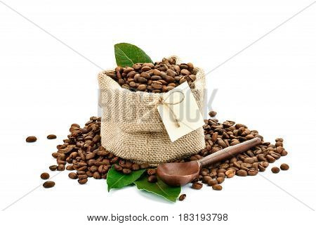 Coffee beans in a bag of sackcloth on a white background with blank tag. Isolated.