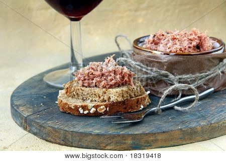 pate of duck meat Rillettes de Canard  with a glass of wine poster
