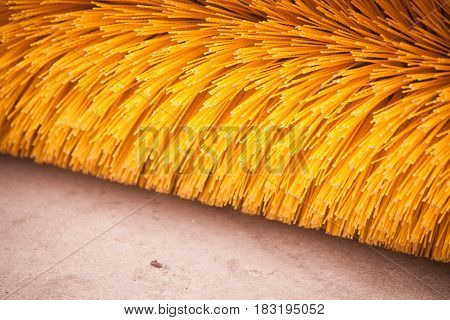 Close up shot of a road brush sweeping machine.