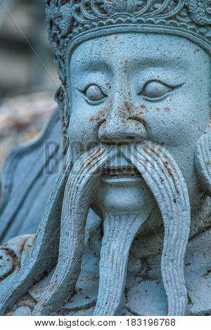 Closeup Chinese giant stone statue at Wat Arun temple Bangkok Thailand
