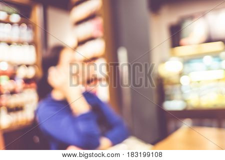 Blurred Background : Vintage Filter ,woman Talk On Mobile Phone In Coffee Shop Blur Background With