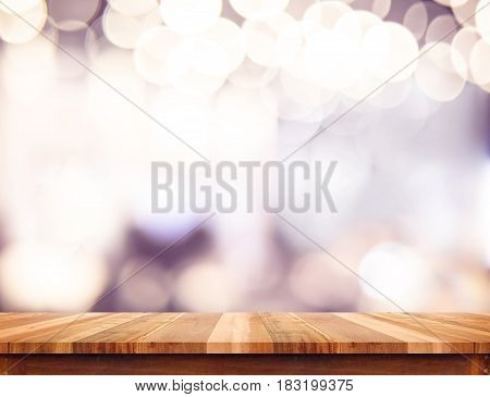 Empty perspective wood plank table top with abstract bokeh light backgroundMock up for montage of your product.