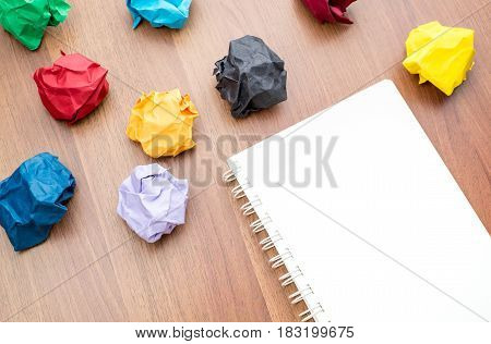 Empty White Notebook Page With Colourful Crumbled Paper (paper Ball) On Dark Brown Table Top, Mock U