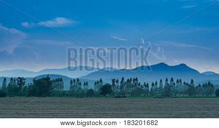The terrain of the mountains and the beautiful sky.