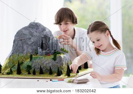 Kids Working On Model Building Project For School