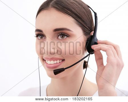 Beautiful young woman with headset indoors