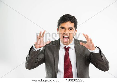 indian young & handsome businessman shouting loudly in office wear standing, isolated over white background